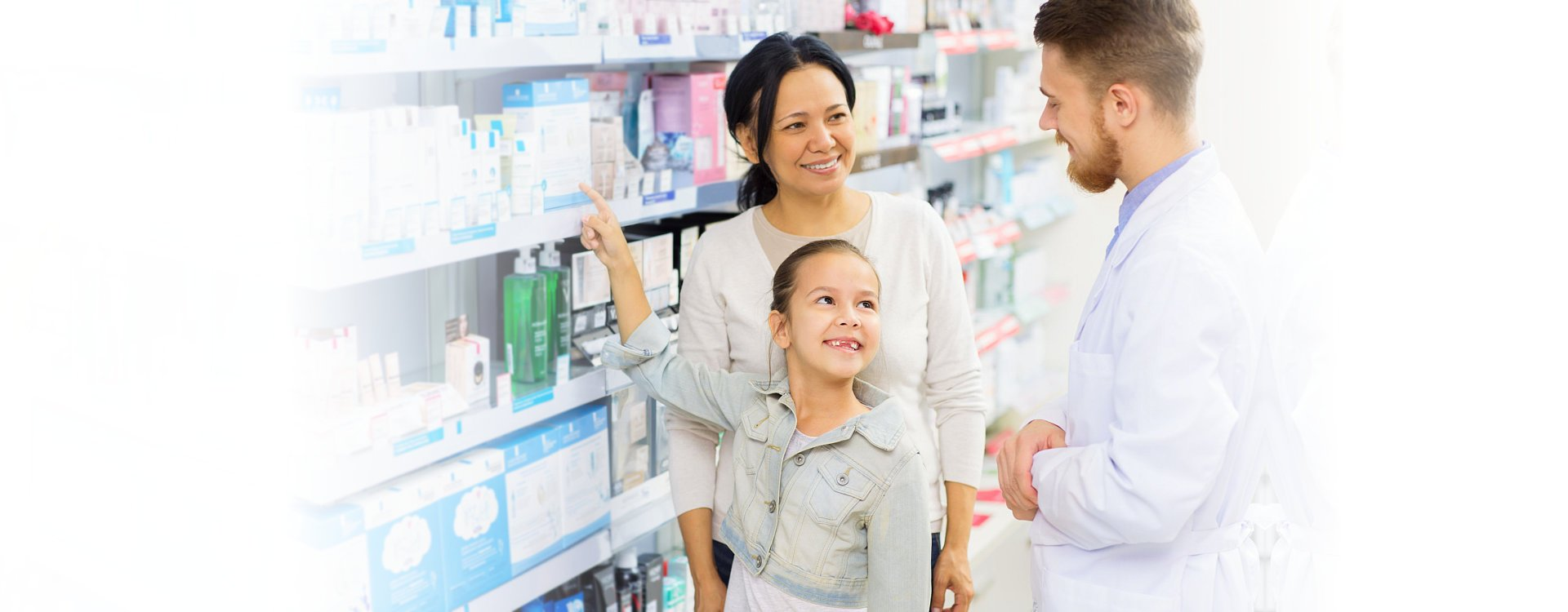 pharmacist with a little girl and her mom