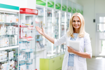 pharmacist standing and smiling